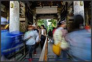 Japanese tourist passing through Yomei-mon Gate, Tosho-gu Shrine, Nikko, Japan