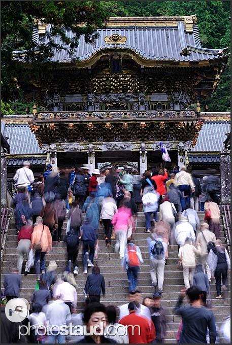 Japanese tourist stepping towards Yomei-mon Gate, Toshogu Shrine, Nikko, Japan