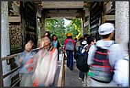 Japanese tourist stepping towards Yomei-mon Gate, Tosho-gu Shrine, Nikko, Japan