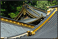 Japanese tourist passing through Yomei-mon Gate, Toshogu Shrine, Nikko, Japan