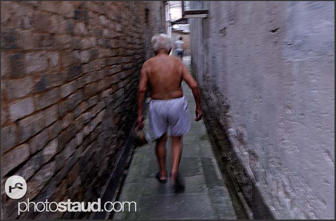 Elderly man disappearing in the narrow streets of Tunxi, Huangshan city, Anhui, China