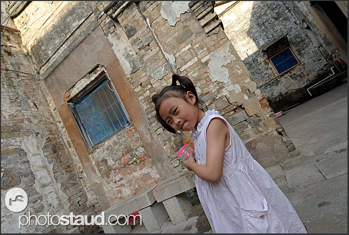 Little Chinese girl playing in Tunxi, Huangshan city, Anhui, China