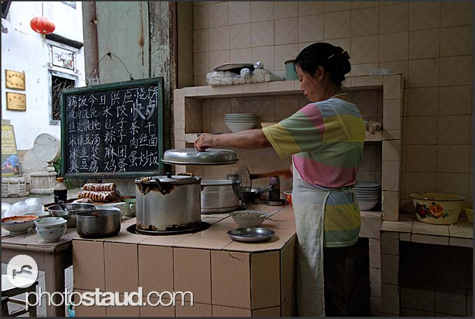 Chinese woman cooking in a restaurant, Tunxi, Huangshan city, Anhui, China