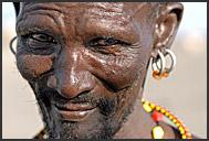 Turkana medicine men wearing clay hairdo and genuine tribal ornaments, Kula Samaki, Northern Kenya