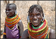 Blind Turkana woman wearing colorful bead necklaces and ear rings, Northern Kenya