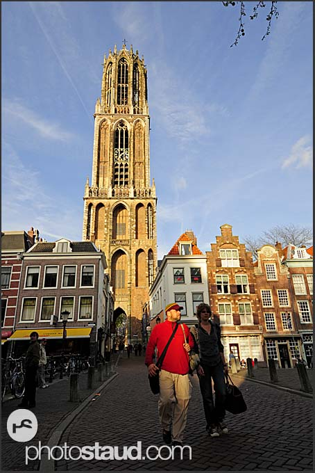 Couple walking across a bridge with Dom tower in the back, Utrecht, The Netherlands, Europe