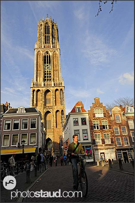 Evening sun illuminating houses and the Dom in Utrecht, The Netherlands, Europe