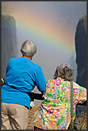 Tourists watching rainbow over Victoria Falls, Zambia