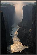 Rainbow and cliffs of Victoria Falls, Zambia