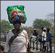 Zimbabweans carrying goods from Zambia across the Victoria Falls Bridge, Zambia