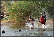 Zambian children playing in Zambezi River near Victoria Falls, Zambia