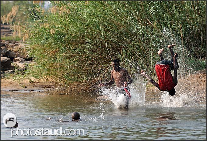Zambian children bathing in Zambezi River near Victoria Falls, Zambia