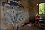 Teacher in a derelict school for Buddhist monks, Bakong Temple school, Angkor, Cambodia