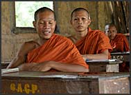 Three Buddhist monk novices sitting in school, Bakong Temple, Angkor, Cambodia
