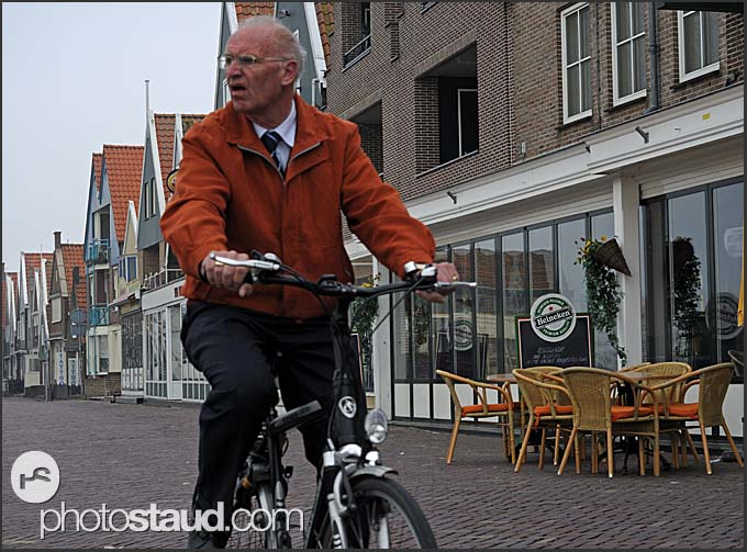 Cyclist on cobbled stones of Volendam, Holland, Europe