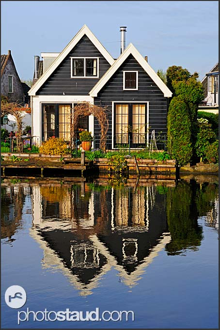 Dutch wooden houses reflecting in Vecht river, Vreeland, The Netherlands, Europe