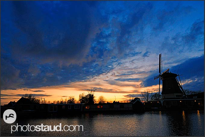 Traditional Dutch windmill and heavy clouds at dusk, Vreeland, The Netherlands, Europe