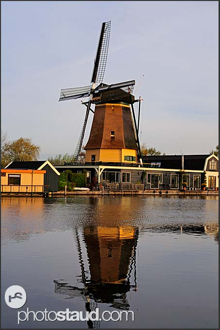 Traditional Dutch windmill reflecting in Vecht river, Vreeland, The Netherlands, Europe
