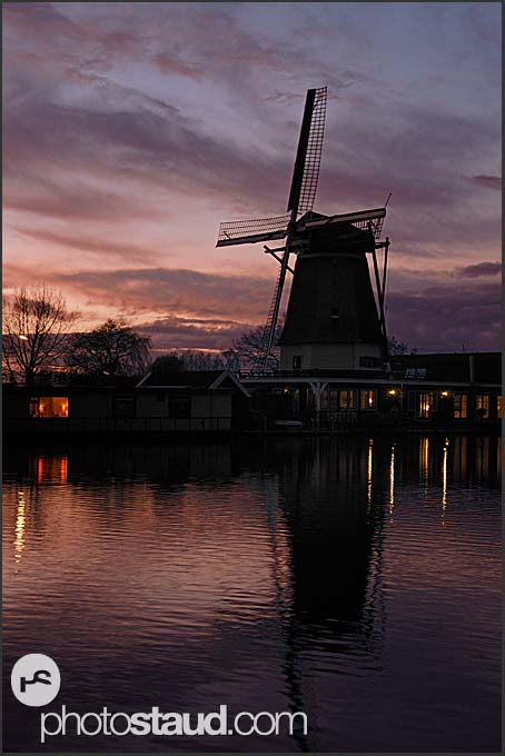 Traditional Dutch windmill reflecting in Vecht river at night, Vreeland, The Netherlands, Europe