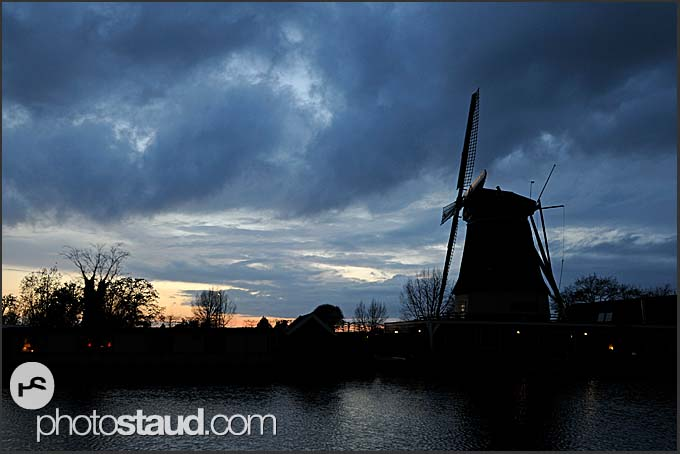 Traditional Dutch windmill and heavy clouds at night, Vreeland, The Netherlands, Europe