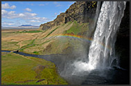 Tourist in front of Seljalandsfoss waterfall, Iceland