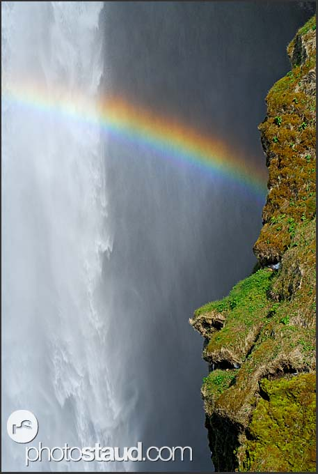 Landscape of Iceland, rainbow over Skogafoss waterfall, Iceland