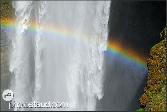 Landscape of Iceland, rainbow over Skogafoss waterfall, Iceland