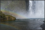Tourists under Skogafoss waterfall, Iceland
