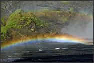Landscape of Iceland, double rainbow over Skogafoss waterfall, Iceland