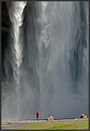 Tourists under Skogafoss waterfall, Iceland