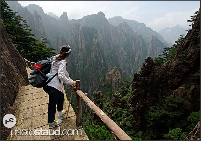 Chinese tourist admiring the landscape of the Yellow Mountains, Huangshan, Anhui, China