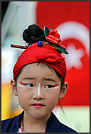 Little Japanese girl in traditional costume smiling at Michinoku YOSAKOI Festival, Sendai, Japan