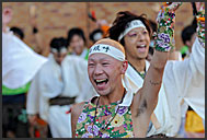 Japanese woman photographing Michinoku YOSAKOI Festival, Sendai, Japan