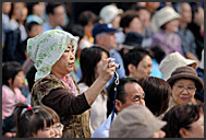 Japanese woman photographing Michinoku YOSAKOI Festival, Sendai, Japan