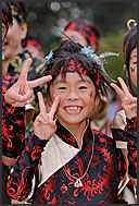 Japanese girls in traditional costumes showing V-sign at Michinoku YOSAKOI Festival, Sendai, Japan