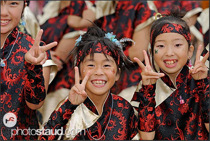 Japanese girls in traditional costumes showing V-sign at Michinoku YOSAKOI Festival, Sendai, Japan