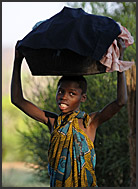 Children fighting on ground, Zambia