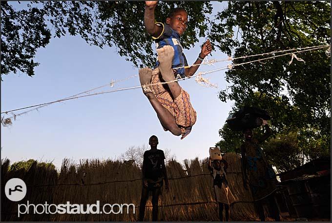 Jumping high - Zambian children at game, Zambia