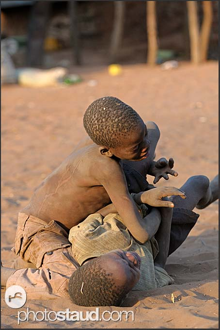 D Exhibition Zambia : Zambian boys fighting in dust zambia village