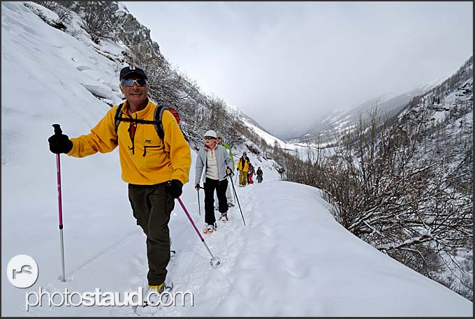 Mountain guide leading snow-shoe expedition to the Zinal Glacier, Switzerland, Europe