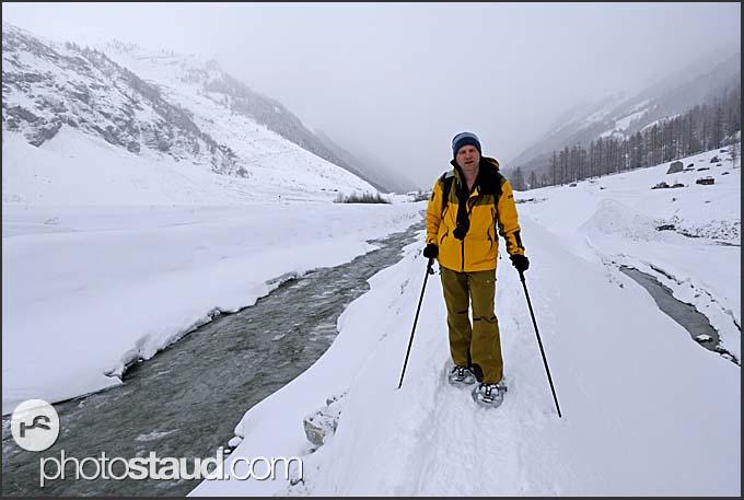 Snow-shoe walking in the Zinal Valley, Switzerland, Europe