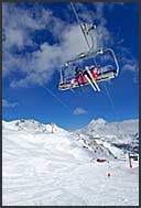 Skiers on chairlift in Grimentz, Swiss Alps, Switzerland, Europe