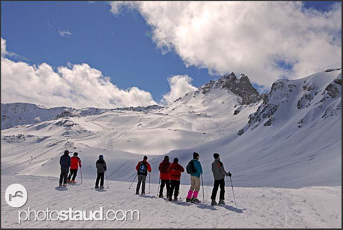 Skiers overlooking the ski slopes of Grimentz, Swiss Alps, Switzerland, Europe