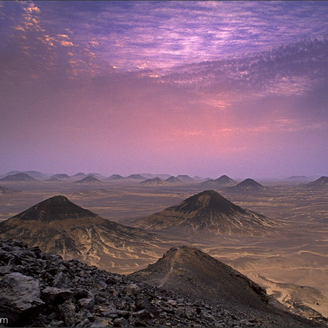 Dusk in the volcanic landscape of the Black Desert, Egypt