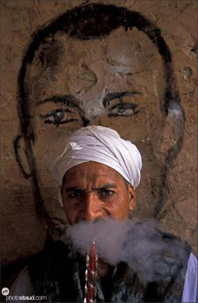 Egyptian man smoking water pipe - hubble bubble or sheesha - in Luxor - Thebes, Egypt