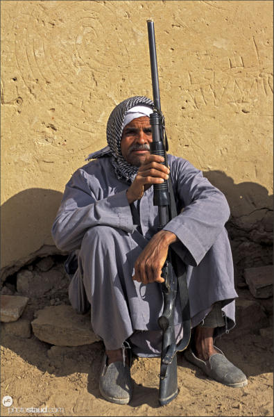 Egyptian man with a gun in his hands, Islamic village, Dakhla Oasis, Egy