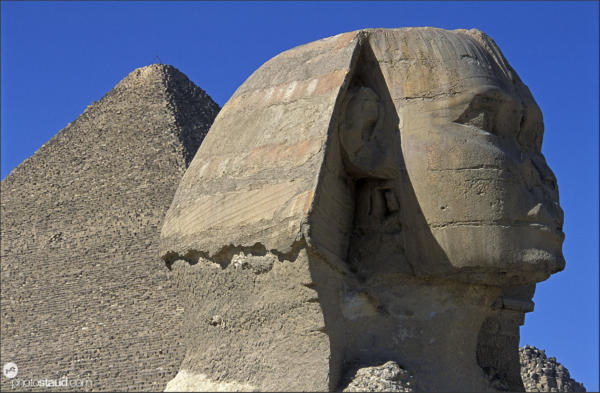 The mighty Sphinx with Khufu pyramid behind, Giza, Egypt