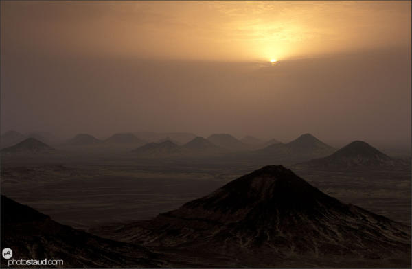 Sunset over the volcanic landscape of the Black Desert, Libyan Desert, Egypt