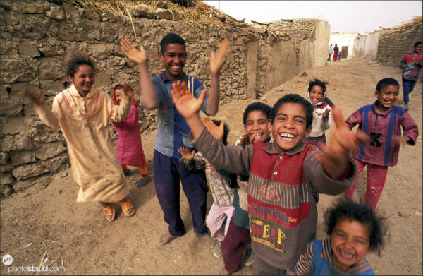 Smiling children of the Bedouin village of El Heiz greeting visitors, Libyan Desert, Egypt