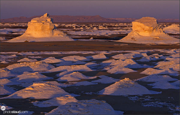 Bizarre colors and shapes in the landscape of White Desert during sunrise, Egypt